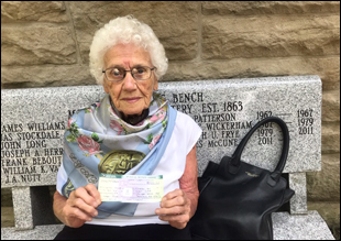 Rose Baxter Gust (above) from the Starkweather Circle Ladies G.A.R. (Grand Army of the Republic) makes symbolic donation to Chapel Restoration Project.